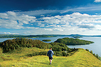A walker descending from Conic Hill along Druim nam Buaraich, Loch Lomond and the Trossachs National Park
