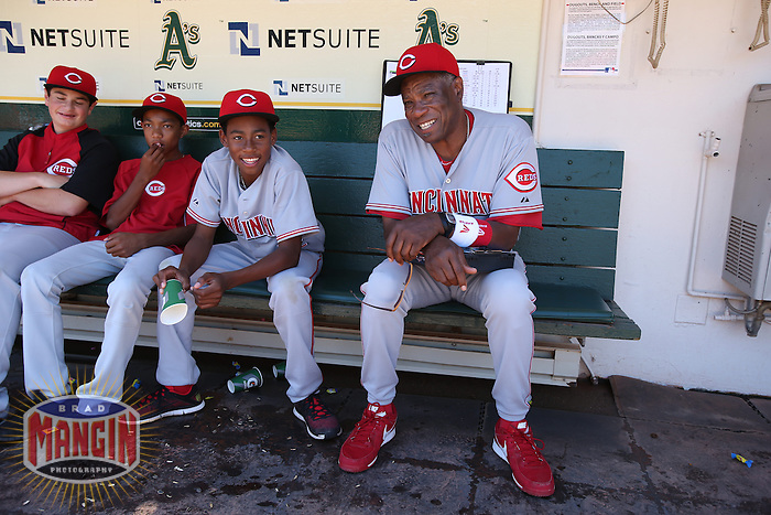 OAKLAND, CA - JUNE 26:  Manager Dusty Baker #12 and his son Darren Baker of the Cincinnati Reds sit in the dugout before the game against the Oakland Athletics at O.co Coliseum on Wednesday June 26, 2013 in Oakland, California. Photo by Brad Mangin