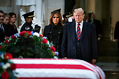 US President Donald J. Trump (R) and his wife, Melania (L), pay respects to former President George H.W. Bush as he lies in state in the Rotunda of the US Capitol in Washington, DC, USA, 03 December 2018. President Bush died at the age of 94 on 30 November 2018; he was the 41st President of the United States (1989–1993).