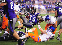 Jan. 4, 2010; Glendale, AZ, USA; TCU Horned Frogs tailback (18) Ryan Christian is upended on a play in the fourth quarter against the Boise State Broncos in the 2010 Fiesta Bowl at University of Phoenix Stadium. Boise State defeated TCU 17-10. Mandatory Credit: Mark J. Rebilas-