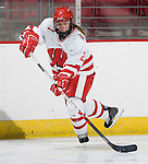 MADISON, WI - SEPTEMBER 29: Jasmine Giles #2 of the Wisconsin Badgers women's hockey team handles the puck during warmups prior to the game against the Quinnipiac Bobcats at the Kohl Center on September 29, 2006 in Madison, Wisconsin. The Badgers beat the Bobcats 3-0. (Photo by David Stluka)