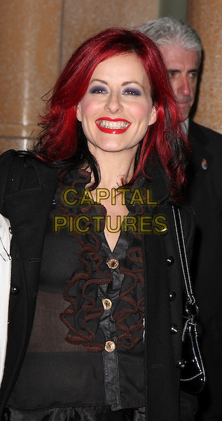"CARRIE GRANT .Attending the ""Twilight"" UK Premiere  at the Vue Cinema, Leicester Square,  London, England, December 3rd 2008..half length black sheer ruffle blouse bra see through shirt coat red lipstick dyed hair.CAP/ROS.©Steve Ross/Capital Pictures"