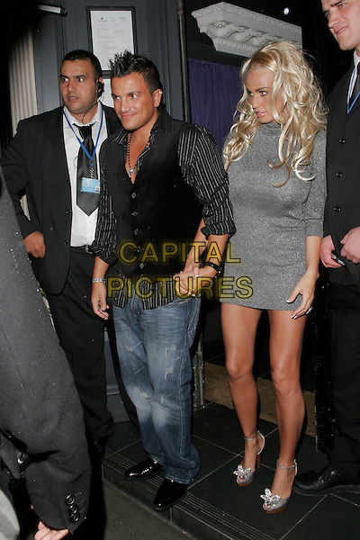 PETER ANDRE & KATIE PRICE.ariving at Embassy Club.outside Modiva club.20th September 2007 London, England.full length waistcoat blue demin jeans Jordan married couple husband wife black shirt waistcoat holding hands grey silver sweater dress platform shoes.CAP/AH.©Adam Houghton/Capital Pictures.
