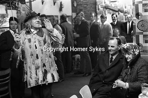 Eddie Hardcastle leader of the Ripon Sword Dance Play mummers performing in a pub in Ripon Boxing Day 1972.<br />