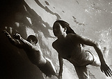 MEXICO, Baja, man and woman swimming in the Pacific, Cabo San Lucas (B&W)
