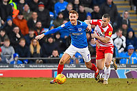 Tommy Rowe of Doncaster Rovers right takes hold of Tom Naylor of Portsmouth during Portsmouth vs Doncaster Rovers, Sky Bet EFL League 1 Football at Fratton Park on 2nd February 2019