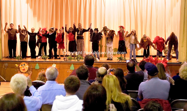 """PLYMOUTH, CT- 03 APRIL 2007 -040307JW03.jpg -- Members of Plymouth Fisher Middle School Fisher Drama Club take their bows after their perfomances in """"Anansi and the Moss Covered Rock"""" and """"Coyote, the Firebringer"""" Tuesday evening at the middle school. Jonathan Wilcox Republican-American"""
