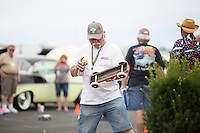 Bill MacKenzie adds lubrication to the wheels of his valve cover race car during the 4th State Representative Chevy Show on Saturday, July 2, 2016, in Fort Wayne, Indiana. (Photo by James Brosher)