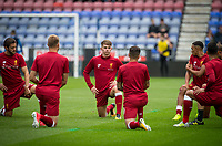 Ben Woodburn (centre) of Liverpool & teammates warm up  ahead of the pre season friendly match between Wigan Athletic and Liverpool at the DW Stadium, Wigan, England on 14 July 2017. Photo by Andy Rowland.