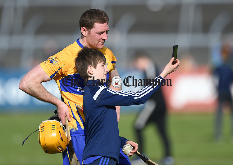 Cian Dillon of Clare poses with a young fan for a selfie following their National League game against Waterford at Cusack Park. Photograph by John Kelly.