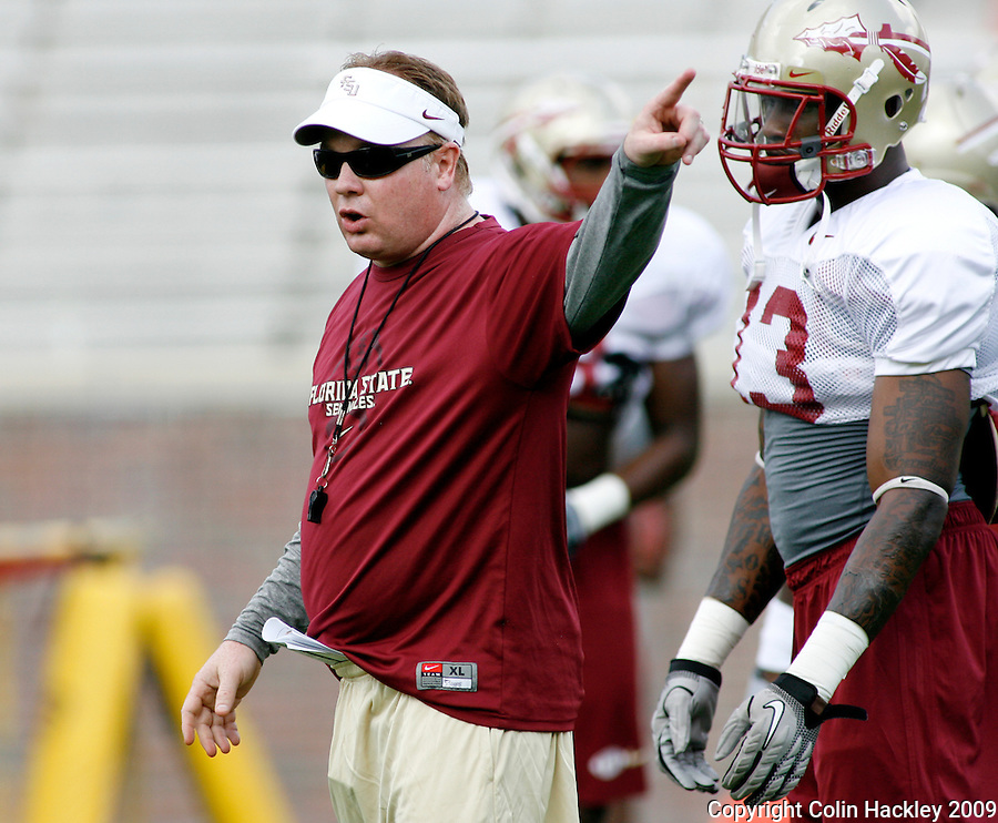 TALLAHASSEE, FL 8/8/10-FSU-080810 CH-Florida State Defensive Coordinator Mark Stoops, center, directs his players during practice Sunday in Tallahassee. .COLIN HACKLEY PHOTO