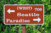 Road sign choice between Seattle or Paradise in Mt Rainier National Park, WA State