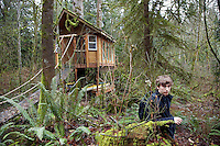 USA. Washington state. Fall City. ReStart Internet Addiction Recovery program at Heavensfield Retreat Center. Leisure time near the treehouse. Josh is 20 years old and has dropped out of university because he was an highly addictive online video gamer on internet. ReStart is an unique intensive onsite program which offers to participants an opportunity to stay in a retreat center designed to promote insight and renewal, disconnect from digital distractions, and engage in coaching and mentoring while building a blue print for change. The three to six-month reStart program, the first of this kind in the United States, works to help men over 18, suffering from problematic internet, video game, social media and technology use by teaching positive and sustainable lifestyle change in a serene, rural environment surrounded by nature. 11.12.2014 © 2014 Didier Ruef
