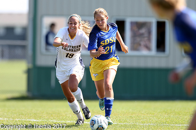 BROOKINGS, SD - SEPTEMBER 17:  Tori Poole #21 from South Dakota State University controls the ball in front of Jacqui Pulley #19 from Northern Colorado during their game Sunday afternoon at Fischback Soccer Field in Brookings. (Photo by Dave Eggen/Inertia)