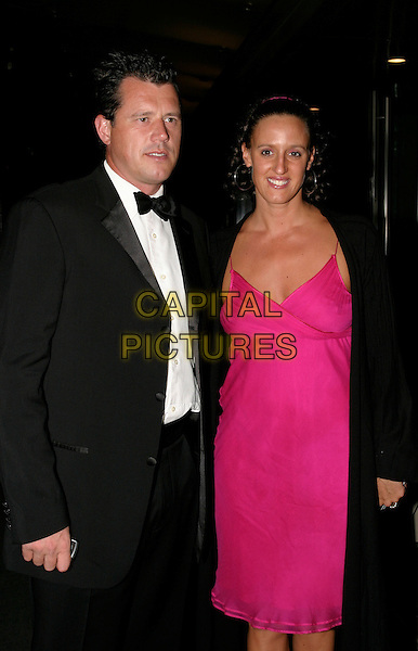 KAREN PICKERING & GUEST.The 22nd Annual Sport Ball at the Hilton,.London, 14th September 2005.half length black tuxedo white shirt pink strappy dress coat.Ref: AH.www.capitalpictures.com.sales@capitalpictures.com.© Capital Pictures.
