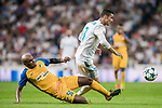 Cristiano Ronaldo (r) of Real Madrid fights for the ball with Carlos Roberto Da Cruz Junior, Cariao, of APOEL FC during the UEFA Champions League 2017-18 match between Real Madrid and APOEL FC at Estadio Santiago Bernabeu on 13 September 2017 in Madrid, Spain. Photo by Diego Gonzalez / Power Sport Images