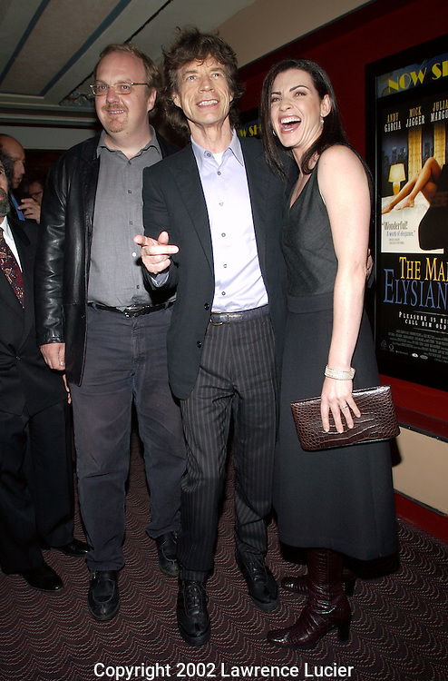 NEW YORK-SEPTEMBER 29: Director George Hickenloper (L), recording artist Mick Jagger (center) and actress Julianna Margulies (R) arrives at the premier of the film The Man from Elysian Fields September 29, 2002, in New York City.