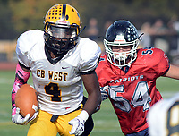 Central Bucks West's Ricardo Washington (4) runs for a short gain as Central Bucks East's Otto Maeglin (54) gives chase in the third quarter Saturday, October 21, 2017 at Central Bucks East in Buckingham, Pennsylvania. (WILLIAM THOMAS CAIN / For The Philadelphia Inquirer)