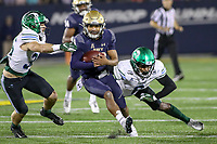 Annapolis, MD - October 26, 2019: Navy Midshipmen quarterback Malcolm Perry (10) breaks a tackle during the game between Tulane and Navy at  Navy-Marine Corps Memorial Stadium in Annapolis, MD.   (Photo by Elliott Brown/Media Images International)