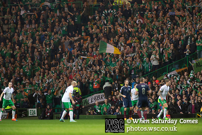 Scotland 1 Republic of Ireland 0, 14/11/2014. Celtic Park, European Championship qualifying. Visiting Irish fans watching the first-half action during the European Championship qualifying match between Scotland and the Republic of Ireland at Celtic Park, Glasgow. Scotland won the match by one goal to nil, scored by Shaun Maloney 16 minutes from time. The match was watched by 55,000 at Celtic Park, the venue chosen to host the match due to Hampden Park's unavailability following the 2014 Commonwealth Games. Photo by Colin McPherson.