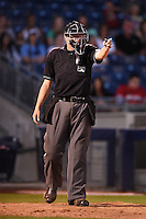 Home plate umpire Matthew Czajak during the second game of a doubleheader between the Frisco Rough Riders and Tulsa Drillers on May 29, 2014 at ONEOK Field in Tulsa, Oklahoma.  Frisco defeated Tulsa 3-2.  (Mike Janes/Four Seam Images)