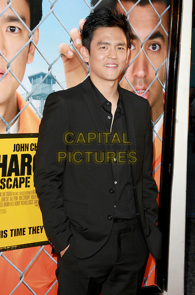 "JOHN CHO .""Harold and Kumar Escape From Guantanamo Bay"" Los Angeles Premiere held at the ArcLight Cinerama Dome Theatre, Hollywood, California, USA, 17 April 2008..half length suit shirt black.CAP/ADM/`CH.©Charles Harris/Admedia/Capital PIctures"