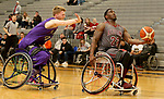MARSHALL, MN - MARCH 17:  Dequel Robinson #22 from Alabama takes the ball to the basket past Micah Sprain #42 form the University Wisconsin Whitwater during their championship game at the 2018 National Intercollegiate Wheelchair Basketball Tournament at Southwest Minnesota State University in Marshall, MN. (Photo by Dave Eggen/Inertia)