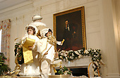 The White House Christmas decorations were shown to the press on December 3, 2001.  Even though the Executive Mansion has been closed to tourists since the 9/11 terrorist attacks, the annual ritual of decorating the house continues.   Christmas Carolers form the centerpiece of the table in the State Dining Room.  <br /> Credit: Ron Sachs / CNP