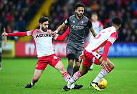 Lincoln City's Bruno Andrade gets between Stevenage's Michael Timlin, left, and Stevenage's Terence Vancooten<br /> <br /> Photographer Andrew Vaughan/CameraSport<br /> <br /> The EFL Sky Bet League Two - Stevenage v Lincoln City - Saturday 8th December 2018 - The Lamex Stadium - Stevenage<br /> <br /> World Copyright © 2018 CameraSport. All rights reserved. 43 Linden Ave. Countesthorpe. Leicester. England. LE8 5PG - Tel: +44 (0) 116 277 4147 - admin@camerasport.com - www.camerasport.com