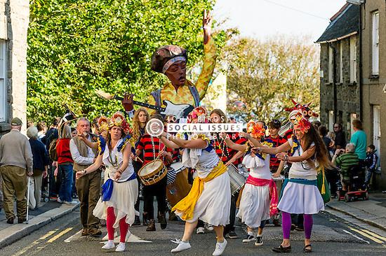 Dakadoum Samba Band and dancers take part in the Penryn Festival in Cornwall.