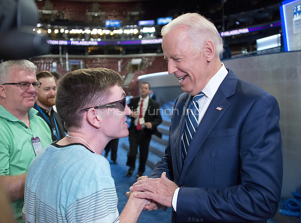United States Vice President Joe Biden greets Timmy Kelly, 23, of Philadelphia, Pennsylvania who was born blind and with cerebral palsy will sing the National Anthem to open the second day of the 2016 Democratic National Convention held at the Wells Fargo Center in Philadelphia, Pennsylvania on Tuesday, July 26, 2016. Timmy, a senior music major at Temple University is  known as the Eagles' &quot;good luck charm&quot; because of their win record when he sings before their games.<br /> Credit: Ron Sachs / CNP/MediaPunch<br /> (RESTRICTION: NO New York or New Jersey Newspapers or newspapers within a 75 mile radius of New York City)