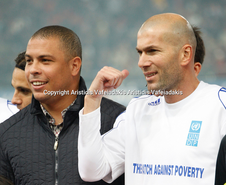 RONALDO(L) and ZINEDINE ZIDANE(R) talk before the match. Goodwill ambassadors RONALDO and ZINEDINE ZIDANE include among others football stars, More than 30 international football players from top teams around the world compete in Match Against Poverty hosted this year by Olympiacos football club in Piraeus, Greece.