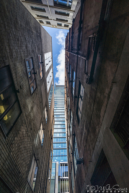 Looking up between the buildings on Temperance Lane, Sydney, NSW, Australia