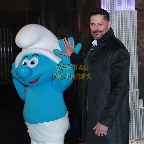 NEW YORK, NY - MARCH 20: Joe Manganiello participates in the ceremonial lighting of the Empire State Building in blue to honor the &ldquo;Small Smurfs Big Goals&rdquo; campaign and the International Day of Happiness on March 20, 2017 in New York City. <br /> CAP/MPI/DIE<br /> &copy;DIE/MPI/Capital Pictures