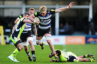 David Denton of Bath Rugby takes on the Sale Sharks defence. Aviva Premiership match, between Bath Rugby and Sale Sharks on April 23, 2016 at the Recreation Ground in Bath, England. Photo by: Patrick Khachfe / Onside Images