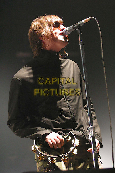 OASIS - LIAM GALLAGHER .In Concert In Berlin.Ref: F2F.tambourine, microphone, singing, half length, half-length, live, stage, music.www.capitalpictures.com.sales@capitalpictures.com.Supplied by Capital Pictures