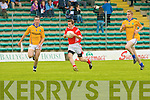East Kerry's Michael O'Shea and Feale Rangers Brian McGuire.