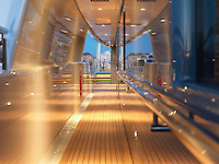 Illuminated teak-decked walkways run the length of the vessel