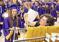 Graduates receive their tassels for membership in National Honor Society and honor diplomas prior to the commencement ceremony.