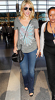 Shakira looked stylish with short blonde hair and Indian Chief print shirt while arriving at LAX. Los Angeles, California on 9.6.2012..Credit: Correa/face to face.. / Mediapunchinc NORTEPHOTO.COM