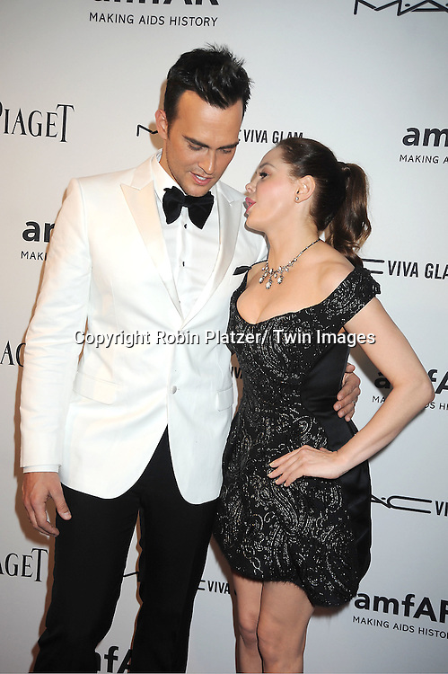 Cheyenne Jackson and Rose McGowen  in Marc Jacobs black dress attends the amfAR Inspiration Gala on June 7, 2012 at The New YOrk Public Library in New York City. The honorees were Fergie and Robert Duffy/ Marc Jacobhs International and the Scissor Sisters performed.
