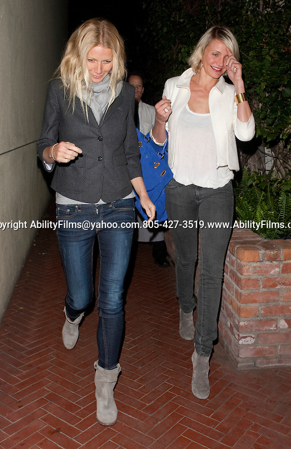 .May 3rd 2012 Exclusive Thursday night Chris Martin &amp; Gwyneth Paltrow eating dinner with friend Cameron Diaz at Spagos restaurant in Beverly Hills. Chris left the restaurant first &amp; jumped in the back seat of the car while Cameron showed off her big new blue suede designer purse handbag Cameron Diaz blue purse is a FONTANA- MILANO 1915 and the model of the bag is named AfeF<br />