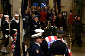 People arrive to pay their respects to former US President George H. W. Bush as he lies in state in the US Capitol's rotunda December 3, 2018 in Washington, DC. - The body of the late former President George H.W. Bush travelled from Houston to Washington, where he will lie in state at the US Capitol through Wednesday morning. Bush, who died on November 30, will return to Houston for his funeral on Thursday. (Photo by Brendan SMIALOWSKI / POOL / AFP)