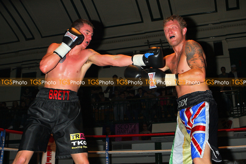 Brett O'Callaghan (black shorts) defeats Andrew Paddy Patterson in a Light-Middleweight boxing contest at York Hall, Bethnal Green, promoted by Miranda Carter / Left Jab Promotions - 13/11/11 - MANDATORY CREDIT: Gavin Ellis/TGSPHOTO - Self billing applies where appropriate - 0845 094 6026 - contact@tgsphoto.co.uk - NO UNPAID USE.