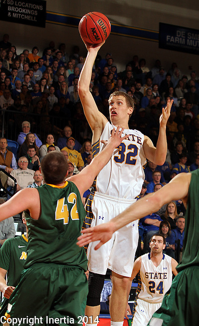 BROOKINGS, SD - JANUARY 25:  Marcus Heemstra #32 from South Dakota State University shoots over Marshall Bjorklund #42 from North Dakota State University in the first half of their game Saturday afternoon at Frost Arena in Brookings. (Photo by Dave Eggen/Inertia)