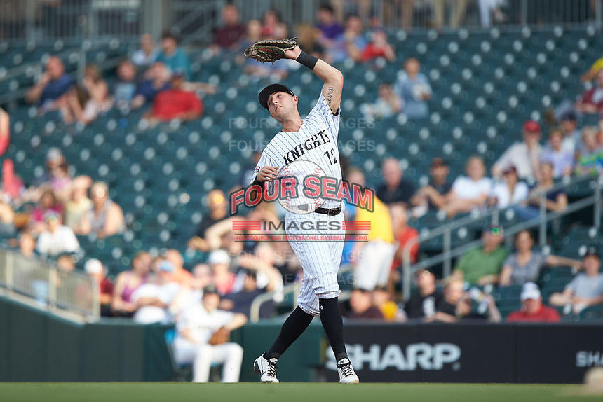 Charlotte Knights first baseman Matt Skole (12) catches a pop fly during the game against the Indianapolis Indians at BB&T BallPark on May 26, 2018 in Charlotte, North Carolina. The Indians defeated the Knights 6-2.  (Brian Westerholt/Four Seam Images)