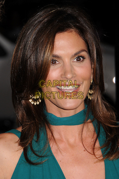 """CINDY CRAWFORD.""""Leatherheads"""" Los Angeles Premiere at Grauman's Chinese Theatre, Hollywood, California, USA..March 31st, 2008.headshot portrait green tie gold earrings.CAP/ADM/BP.©Byron Purvis/AdMedia/Capital Pictures."""