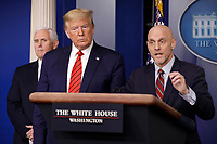 Stephen Hahn, Commissioner, United States Food and Drug Administration (FDA), right, speaks next to US President Donald J. Trump, center, and US Vice President Mike Pence, left, during a press briefing on the Coronavirus COVID-19 pandemic with members of the Coronavirus Task Force at the White House in Washington on March 19, 2020.<br /> Credit: Yuri Gripas / Pool via CNP/AdMedia