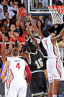 18 November 2010:  FIU's Jeremy Allen (32) puts up a shot over FSU's Xavier Gibson (1) in the first half as the Florida State University Seminoles defeated the FIU Golden Panthers, 89-66, at the U.S. Century Bank Arena in Miami, Florida.