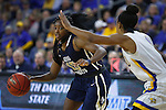SIOUX FALLS, SD: MARCH 5: Faith Ihim #15 of Oral Roberts drives toward Alexis Alexander #1 of South Dakota State during the Summit League Basketball Championship on March 5, 2017 at the Denny Sanford Premier Center in Sioux Falls, SD. (Photo by Dick Carlson/Inertia)